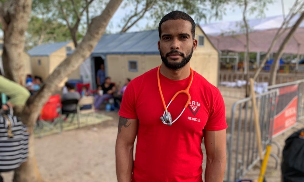 Dr Dairon Rojas, a 28 year-old Cuban seeking asylum, works in a makeshift medical clinic in an encampment in Matamoros, Mexico.