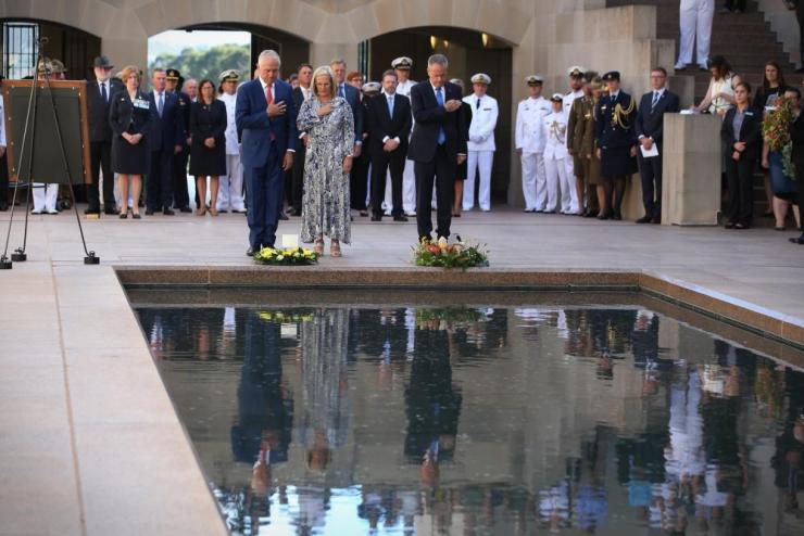 Prime Minister Malcolm Turnbull and Lucy Turnbull with Opposition leader Bill Shorten at a last post ceremony at the Australian War Memorial