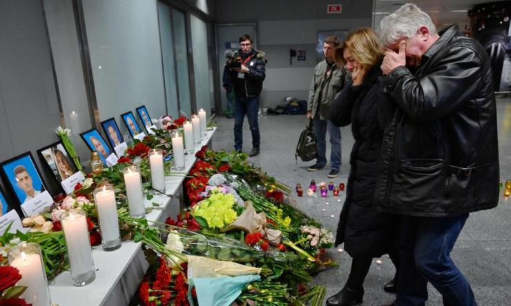 Relatives of the victims of the Ukraine International Airlines Boeing 737-800 crash in the Iranian capital Tehran react by a hasty memorial set up at the Boryspil airport outside Kiev on January 8, 2020.