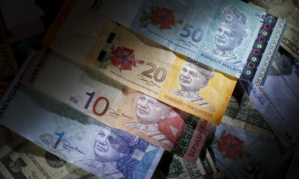 """File photo illustration of Malaysian ringgit notes<br>Malaysian ringgit notes are seen among other currency notes in this photo illustration taken in Singapore in this March 14, 2013 file photo. The Federal Reserve is widely expected to hike interest rates for the first time in almost a decade on Wednesday. REUTERS/Edgar Su/Files FROM THE FILES - BRACING FOR A FED RATE HIKESEARCH """"FED RATE HIKE"""" FOR ALL 36 IMAGES"""