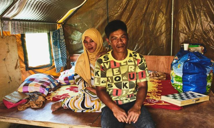 Nor-Ain Ibrahem, 25, sits with her husband, Alanor Batuwaan, 32, in Landar evacuation centre