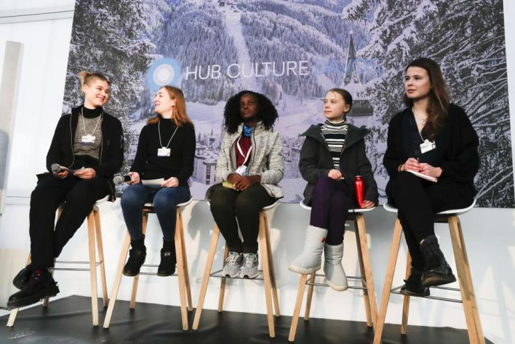 Climate activists Isabelle Axelsson, Loukina Tille, Vanessa Nakate, Greta Thunberg, and Luisa Neubaue,, from left, arrive for a news conference in Davos, Switzerland, Friday, Jan. 24, 2020.
