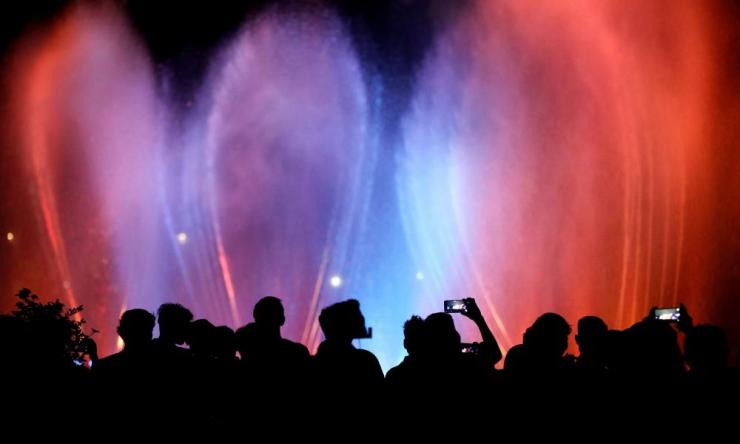 People watch a water show at National Monument (Monas) complex during New Year's Eve celebrations in Jakarta, Indonesia December 31, 2019.