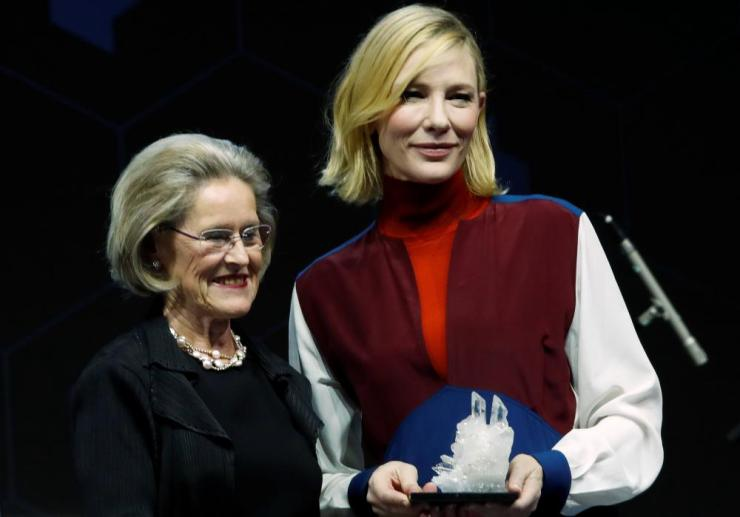 Actor Cate Blanchett receiving a Crystal Award from Hilde Schwab, Co-Founder of the World Economic Forum.