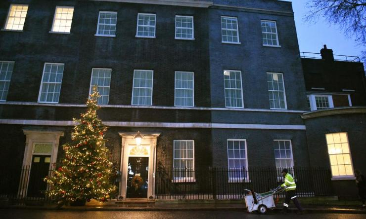 A street cleaner in Downing Street.