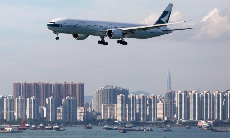 A Cathay Pacific plane prepares to land at Hong Kong international airport.