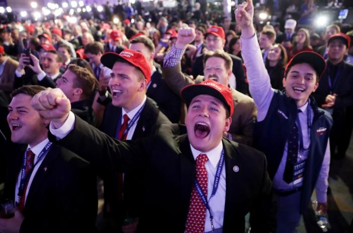 Supporters of Trump cheer at the New York Hilton Midtown as news of victories emerges.
