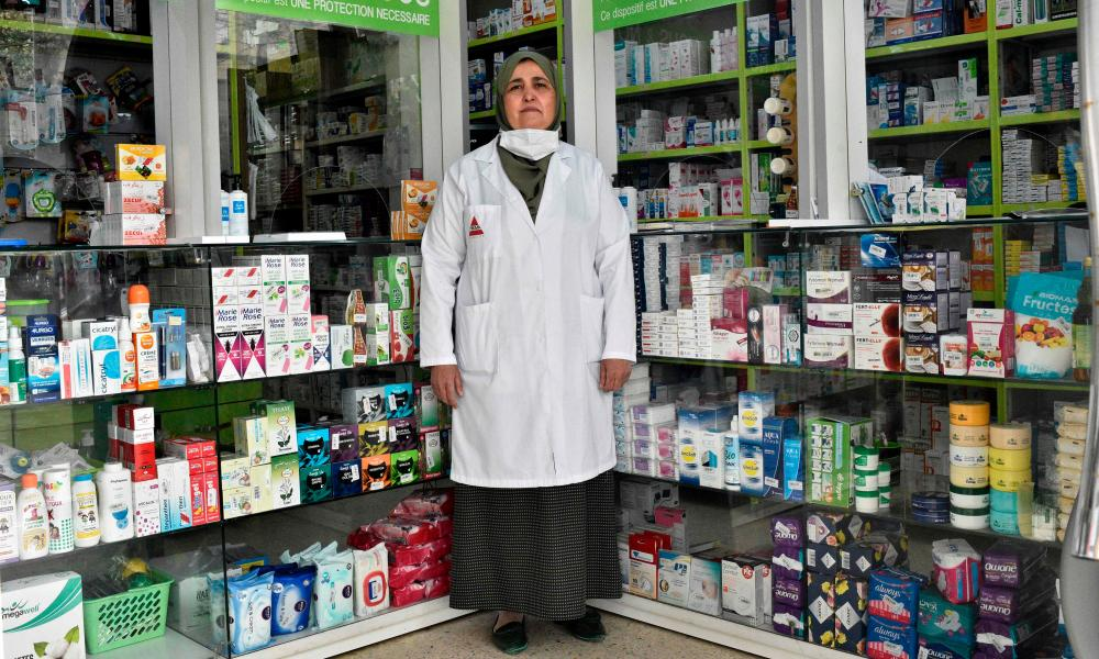 Nassiba Belgherbi, 55, pharmacist, poses for a picture at her pharmacy in Algeria's capital Algiers, on April 23, 2020 during the COVID-19 coronavirus pandemic.