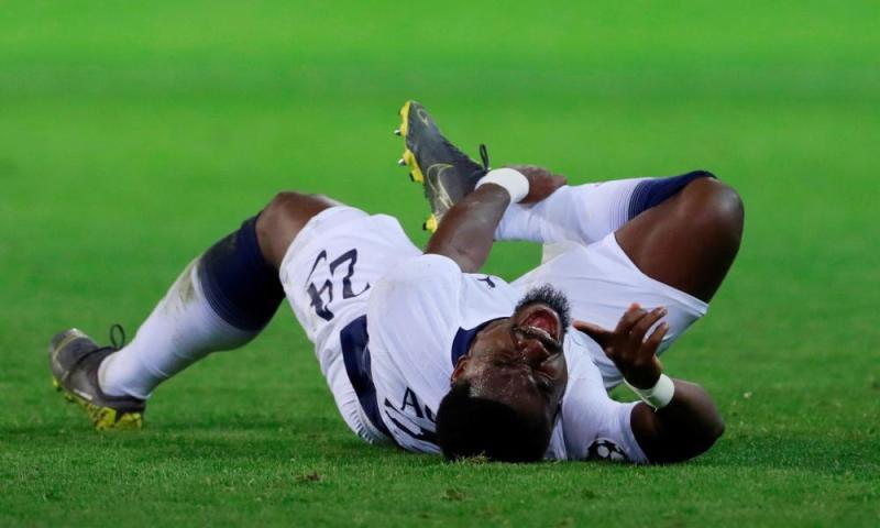 Tottenham's Serge Aurier down injured.