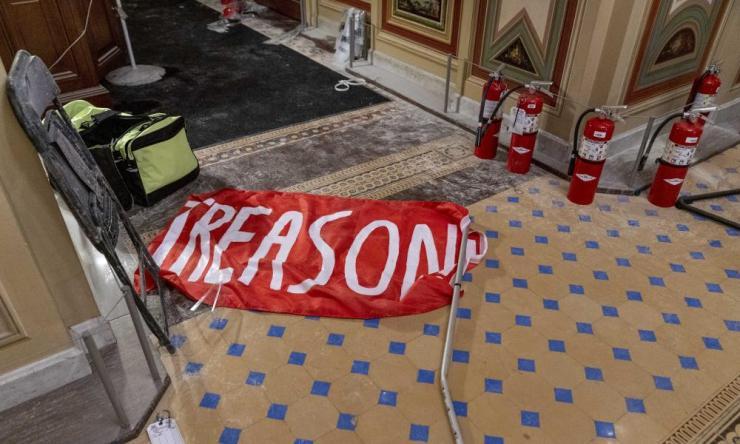 banner on capitol floor says treason