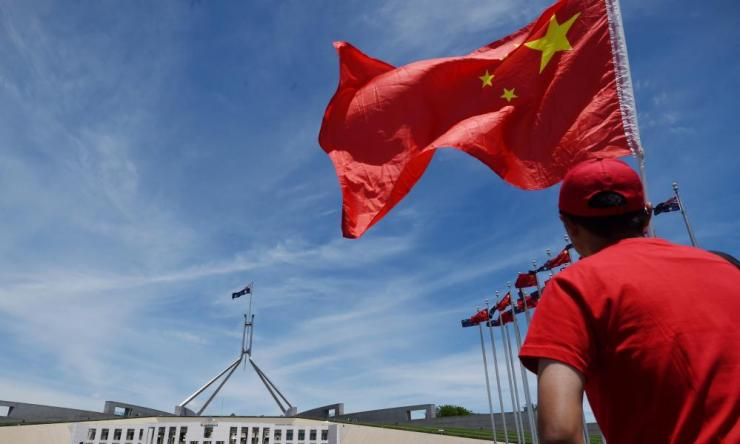 A Chinese flag outside Parliament House in Canberra