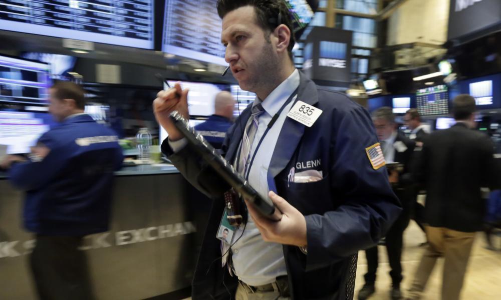 Traders hurry across the floor of the New York Stock Exchange