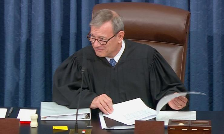 John Roberts, the chief justice of the US supreme court, presides during opening arguments.