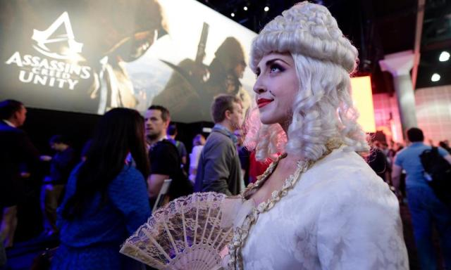 """Although """"booth babes"""" are now widely discouraged, publishers now use both professional and amateur cosplayers to attend stands dressed as game characters. Here's Marie Antoinette from Assassin's Creed Unity"""
