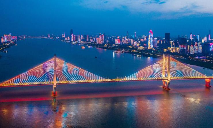 An aerial view of light show which demonstrates various words and phrases to encourage the city and citizens to stay strong and appreciate support other provinces give on the Second Wuhan Yangtze River Bridge.
