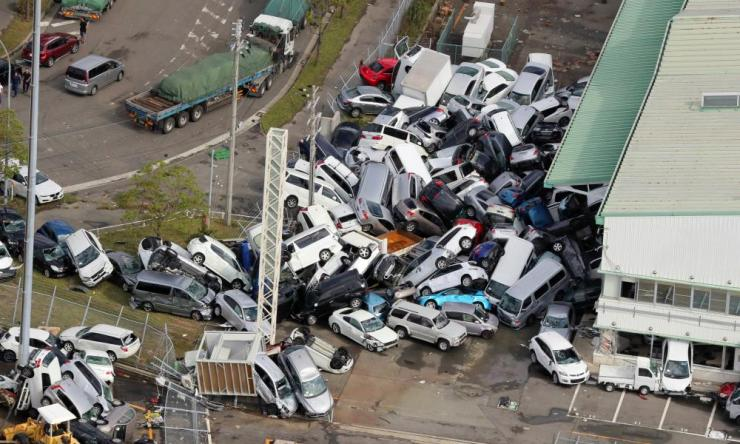 Cars lie piled up a day after powerful Typhoon Jebi hit.