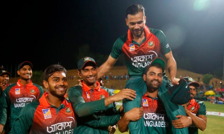 Mashrafe Bin Mortaza (Top) is lifted by his teammate Tamim Iqbal (R) after the third one day international (ODI) cricket match between Bangladesh and Zimbabwe at the International Cricket Stadium in Sylhet on March 6, 2020, shortly before he stepped down as captain.