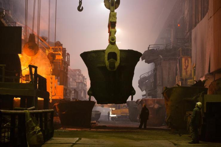 A worker monitors a furnace at the MMC Norilsk Nickel PJSC copper refinery in Norilsk, Russia.