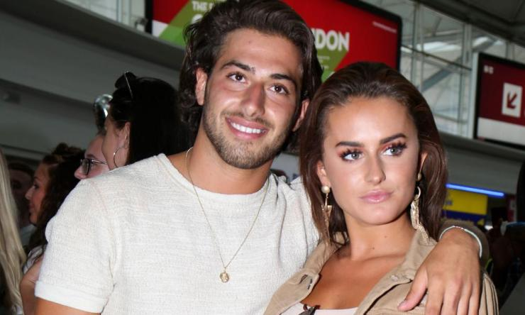 Happy landings: Love Island's Kem Cetinay and Amber Davies at Stansted airport this summer.