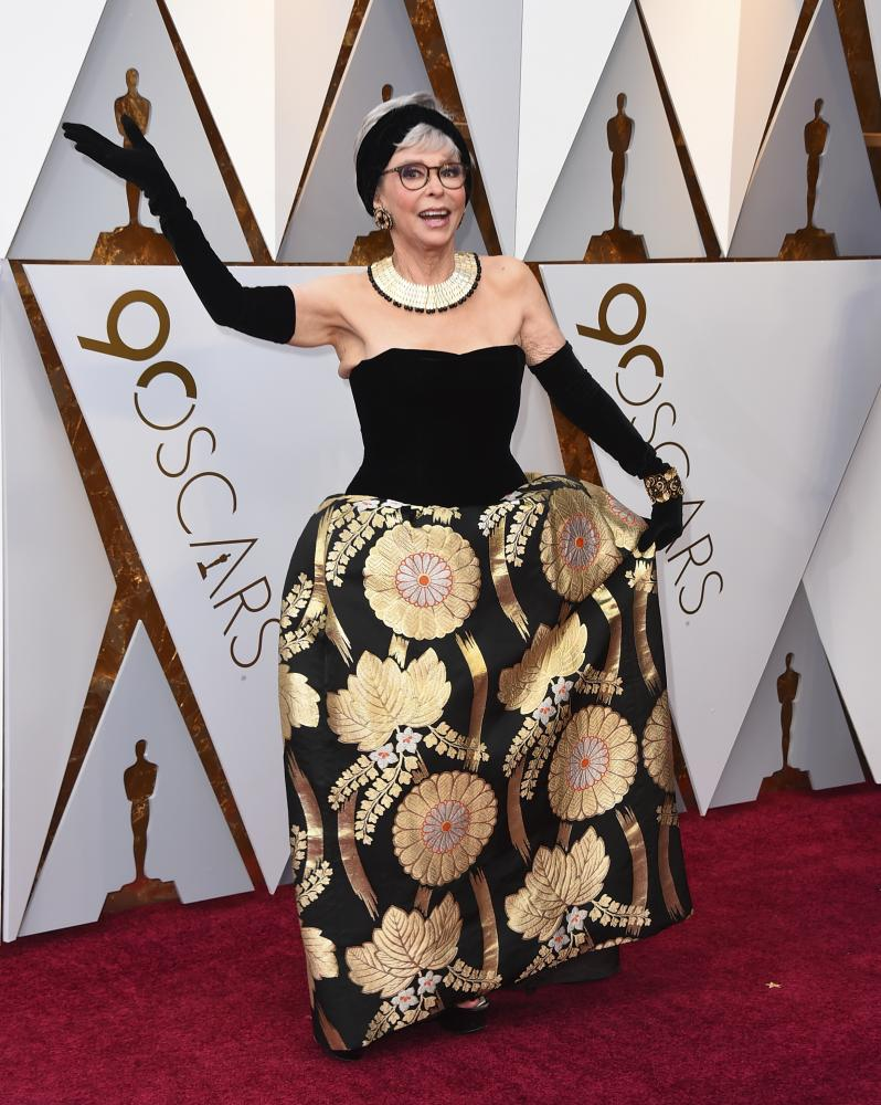 Rita Moreno at the Oscars in the same dress 56 years later.