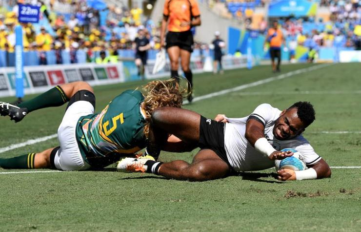 Jerry Tuwai of Fiji breaks away from the defence to score a try in the semi final match between Fiji and South Africa during Rugby Sevens on day 11 of the Gold Coast 2018 Commonwealth Games.