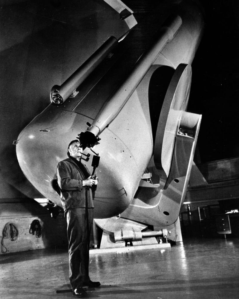 Edwin Hubble uses the Schmidt telescope at Mount Palomar, California, 1949.