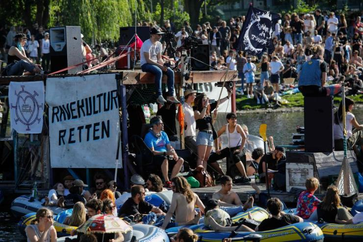 People attend a rave in boats to demonstrate support for Berlin's closed nightclubs.