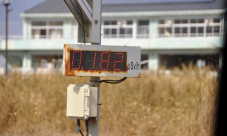 A radiation reading in front of an old school building in the portside area of Ukedo near Namie. This area was hit badly by the tsunami in 2011.