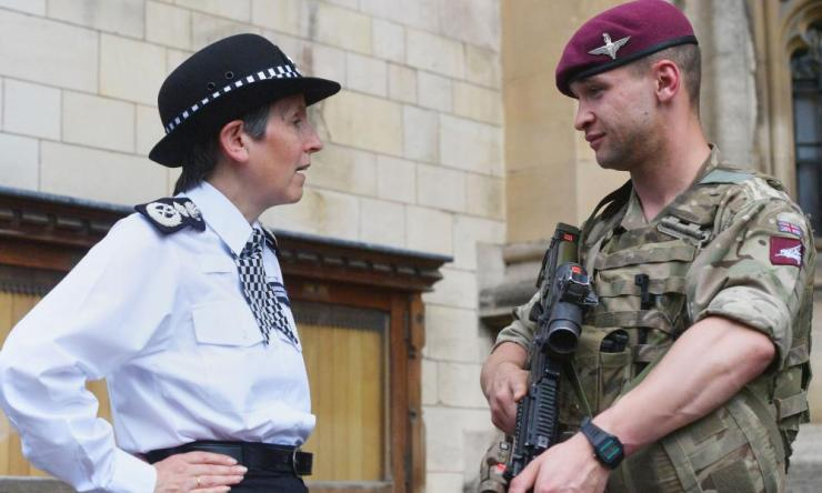 Metropolitan police commissioner Cressida Dick meets a soldier on deployment to assist police officers in the Palace of Westminster, London.
