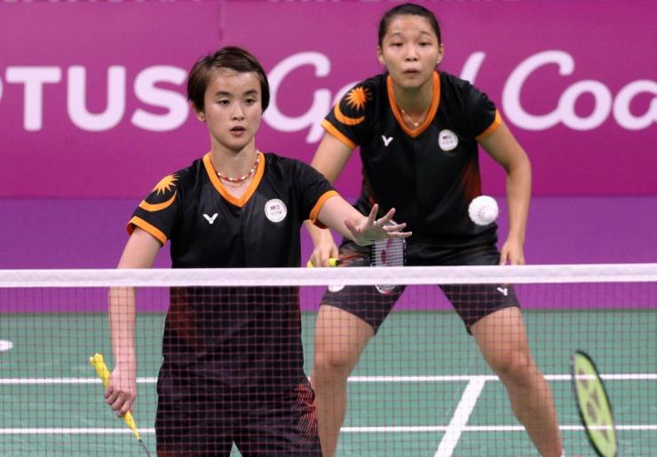 Chow Mei Kuan and Vivian Hoo of Malaysia in action during the final of the Commonwealth Games women's doubles.