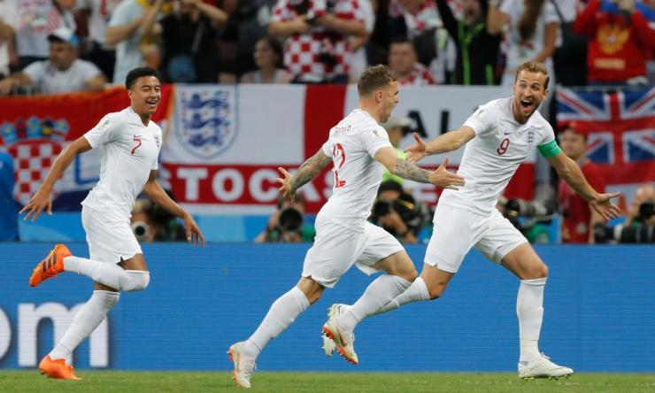 Trippier is congratulated by his team-mates.
