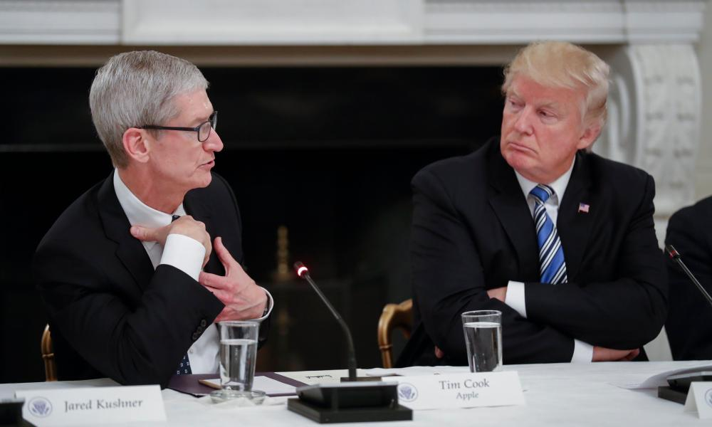 Apple president Tim Cook with Donald Trump. Activists have urged Cook not to hold talks with the president.