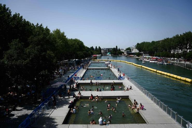 People cool off at floating pools set up on the Ourcq canal in Paris on Thursday.