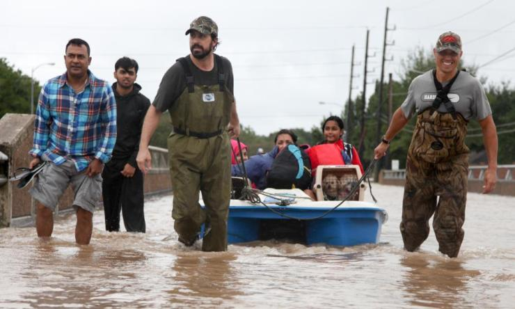 Katy Grande Lakes residents cross a bridge during rescue operations due to flooding from Hurricane Harvey.