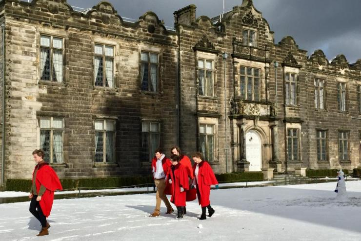 Undergraduates in their gowns in St Salvator's quad at the University of St Andrews