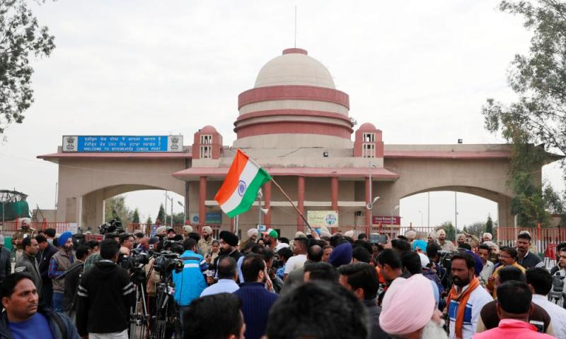 People gather at the Wagah border, on the outskirts of the northern city of Amritsar, India.