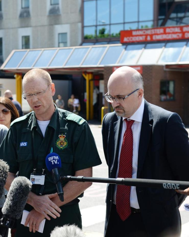 Dr David Ratcliffe (L), medical director of North West ambulance service and Jon Rouse, chief officer of the Greater Manchester Health and Social Care Partnership, speak to the media outside Manchester Royal infirmary.