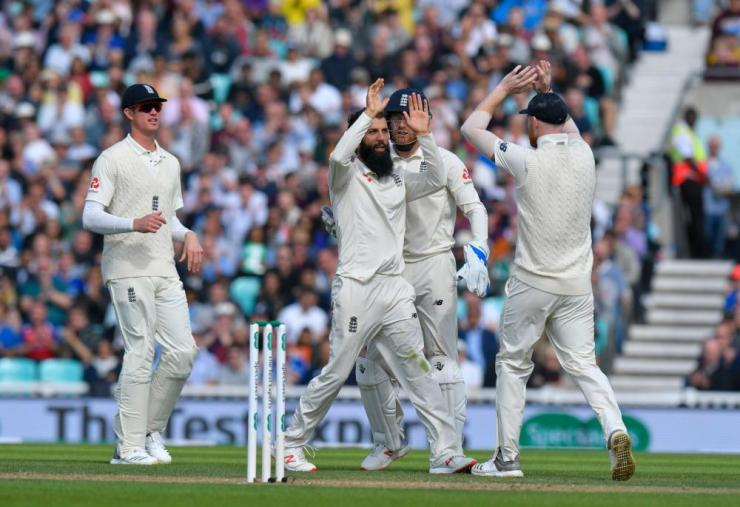 Ali of England celebrates taking the wicket of Vihari.