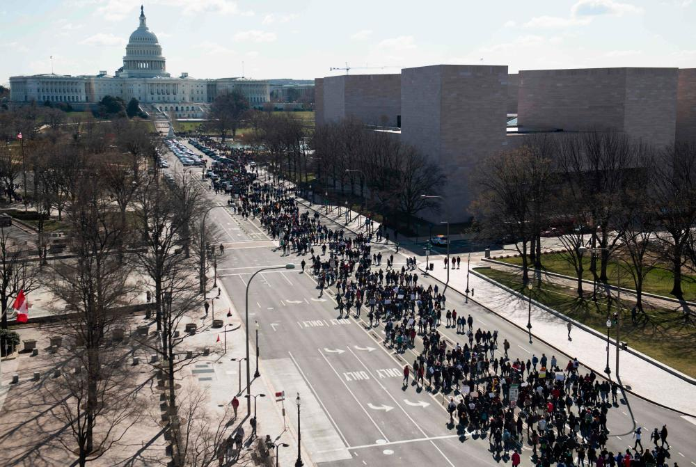 Thousands of students march down Pennsylvania Avenue in Washington, DC.