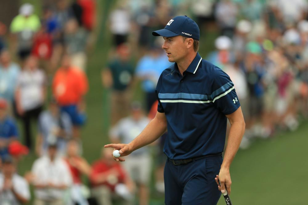 Spieth acknowledges patrons on the 2nd green after his birdie.