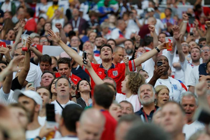 The England fans in the Luzhniki Stadium are enjoying themselves.