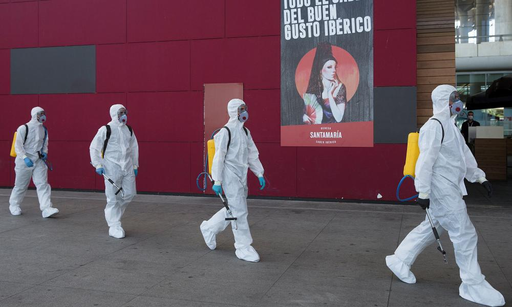 Members of the Military Emergency Unit conduct disinfection works at the International Airport in Malaga, Spain, 16 March 2020.