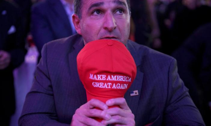 A supporter of U.S. Republican presidential nominee Donald Trump watches results at his election night rally in Manhattan, New York, U.S., November 8, 2016.