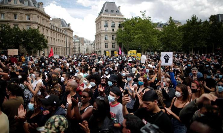 Demonsrators protest against police brutality in Paris at the Place de la Republique square on Saturday.