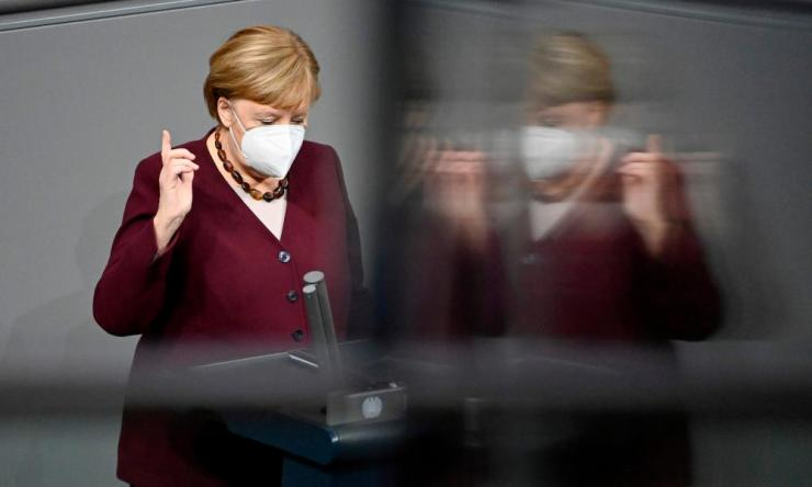 German Chancellor Angela Merkel wears a face mask before delivering a speech during a session at the Bundestag