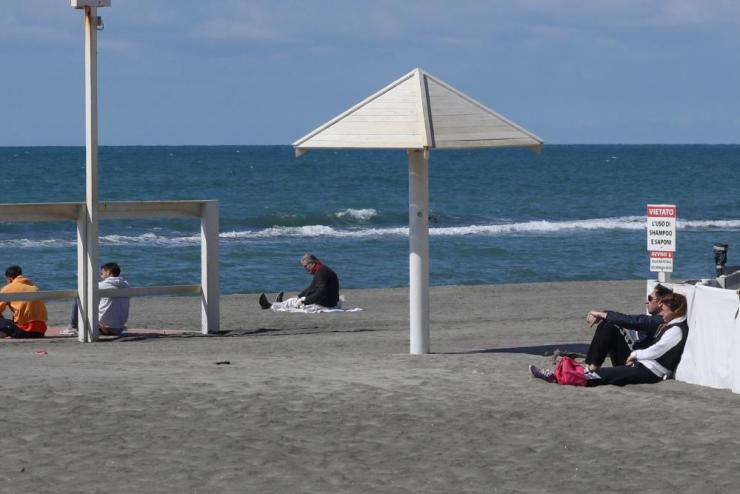 Italians enjoy the quiet beaches at Lungomare di Ostia, Rome, on Monday.