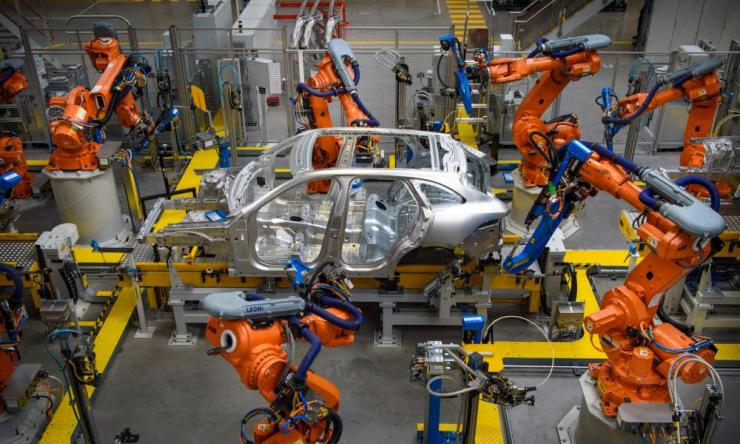 Cars being manufactured in the Aluminium Body Shop, part of Jaguar Land Rover's Advanced Manufacturing Facility in Solihull, Birmingham, March 2017.