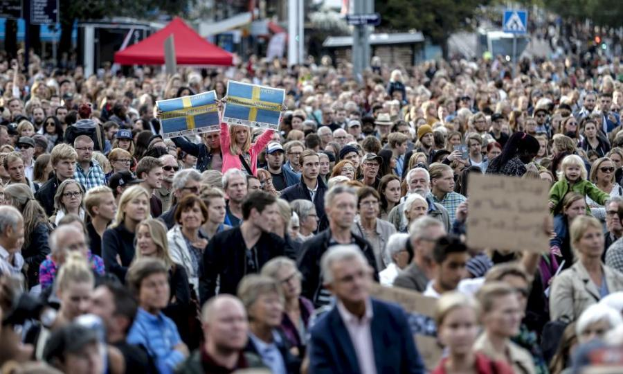People attend a 'Refugees Welcome' demonstration in Gothenburg in September 2015