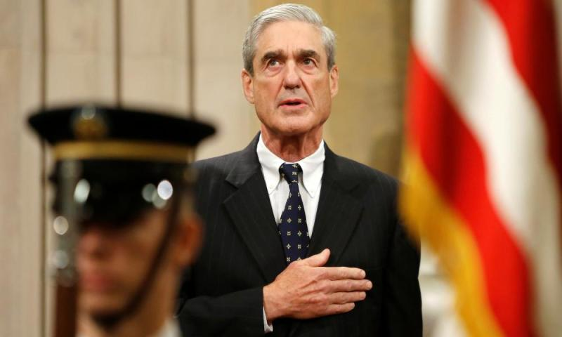 Mueller is always looking for clues. Is that one there on the ceiling!?