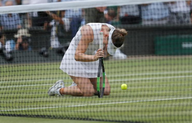 Romania's Simona Halep cries after her victory over Serena Williams in the women's singles final at Wimbledon.